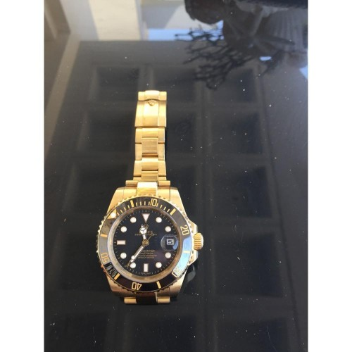 ROLEX SUBMARINER GOLD